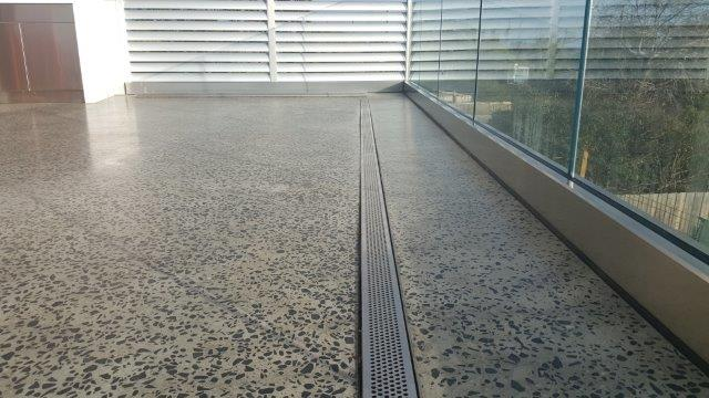 Concrete polished outdoor patios verandahs eco grind for Polished concrete exterior