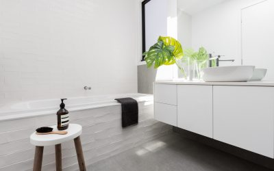 White Themed Bathrooms with Concrete Polished Floors